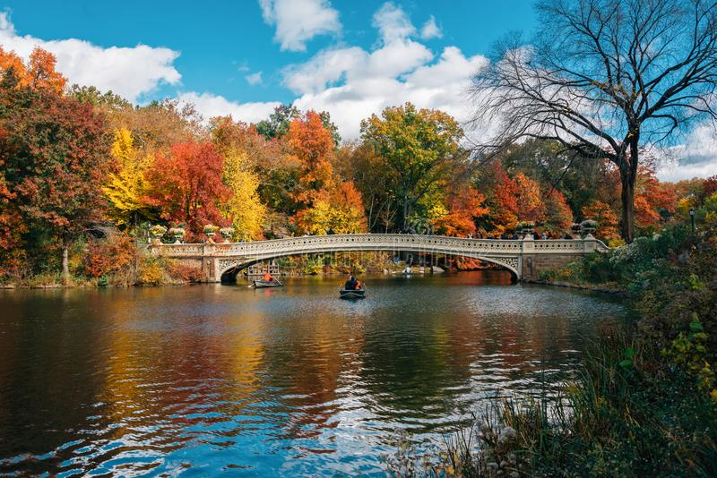 Autumn color and the Bow Bridge, at The Lake, in Central Park, Manhattan, New York City royalty free stock photos
