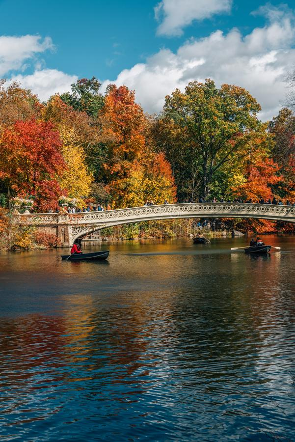 Autumn color and the Bow Bridge, at The Lake, in Central Park, Manhattan, New York City stock photo