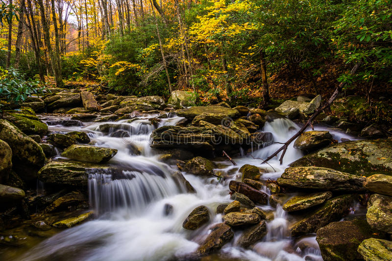 Autumn color and cascades on Boone Fork along the Blue Ridge Par. Kway, North Carolina stock image