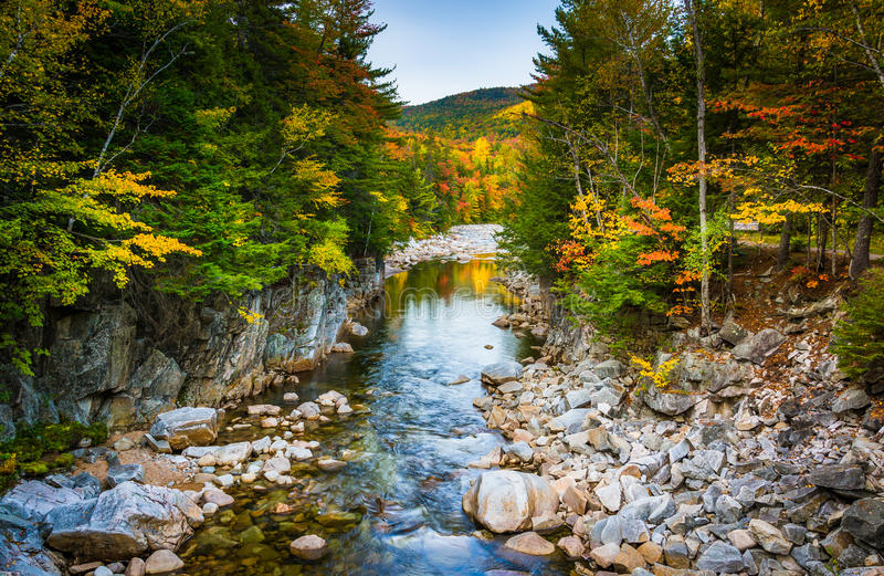 Autumn color and the Swift River at Rocky Gorge, on the Kancamagus Highway, in White Mountain National Forest, New Hampshire. Autumn color and the Swift River stock photos