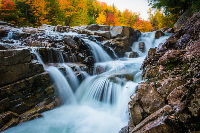 Autumn color and waterfall at Rocky Gorge, on the Kancamagus Highway, in White Mountain National Forest, New Hampshire. Autumn color and waterfall at Rocky stock photography