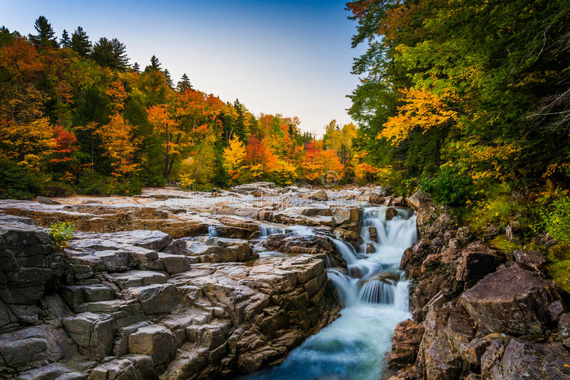 Autumn color and waterfall at Rocky Gorge, on the Kancamagus Highway, in White Mountain National Forest, New Hampshire. Autumn color and waterfall at Rocky royalty free stock image