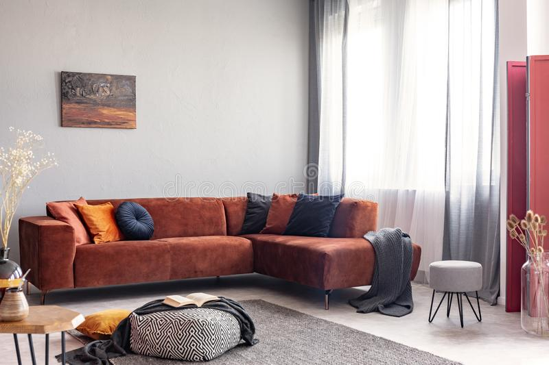 Autumn colored interior of classy living room in modern apartment stock photo