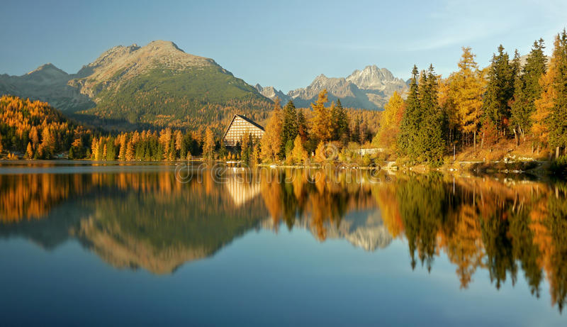 Autumn colored mountain lake - High Tatras. Autumn colored mountain lake and forest with reflection in the lake - High Tatras stock images