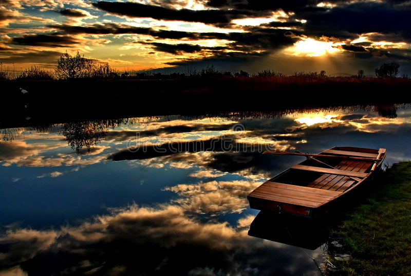 Autumn colors. Shades of autumn colors, peacfully the sky is reflected on a calm lake, all is still, relaxation is granted. Metaphorical meanings by several stock photo