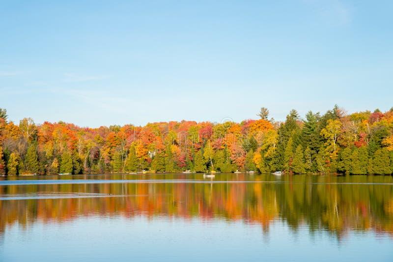 Autumn colors in Quebec, Canada. (Lac Saint-Amour in Sainte-Anne-des-Lacs stock images