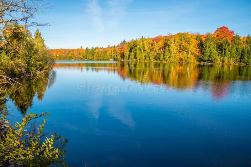 Autumn colors in Quebec, Canada. (Lac Saint-Amour in Sainte-Anne-des-Lacs, Laurentides royalty free stock photography