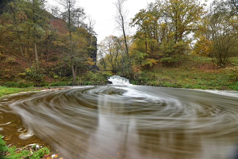 Autumn colors in a slowly flowing creek 3. Autumn colors in a slowly flowing creek royalty free stock photography