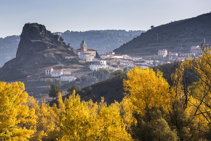 Autumn colors surrounding a small village. Autum colors surrounding a small whitewashed village in Spain. The morning fog adds a bit of serenity to the already royalty free stock photo