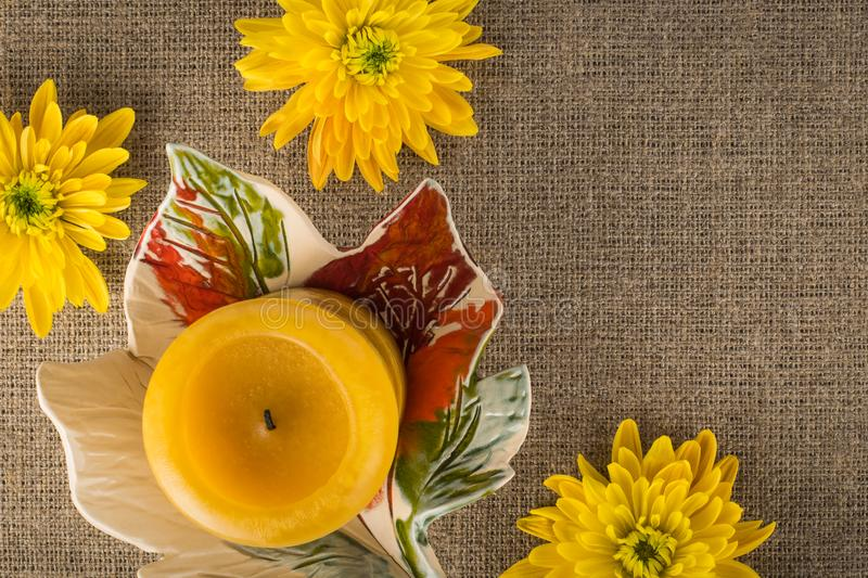 Autumn composition with candle and chrysanthemum flowers stock photos