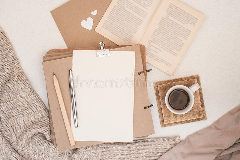 Autumn composition. Cup of coffee, book, blanket, notebook, women fashion sweater. Flat lay, top view, copy space stock images