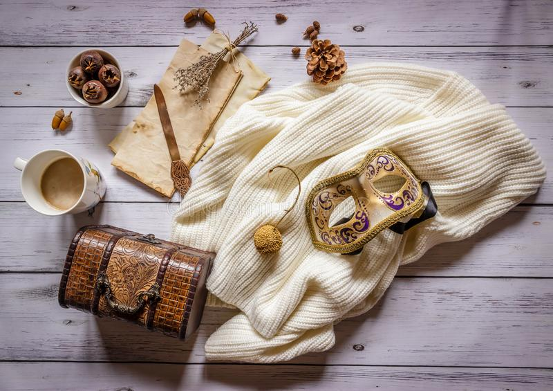 Autumn composition.Old letter, coffee, cone and scarf on wooden b stock image