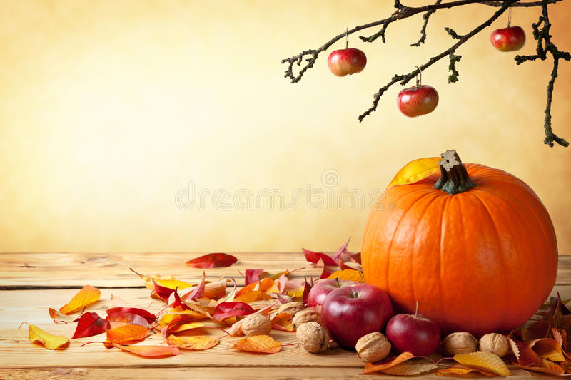 Autumn Concept. Autumn pumpkin composition on wooden table with copy space stock photo