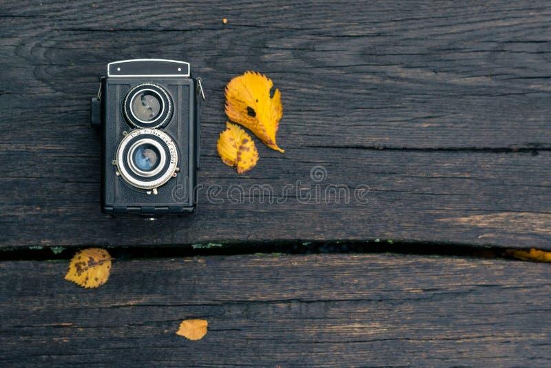 Autumn concert, retro camera on a autum background stock images