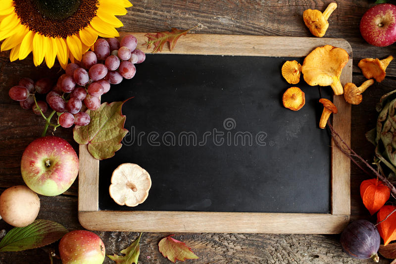 Autumn Cooking Ingredients Including Apples Grapes And Mushrooms Arranged Around A Vintage Slate With Copyspace Colorful Yellow Sunflower Orange