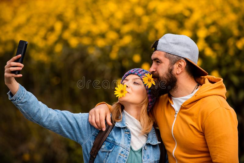 Autumn couple on fall nature background. Romantic portrait of a sensual couple in love. Romantic and love. Sensual royalty free stock photography