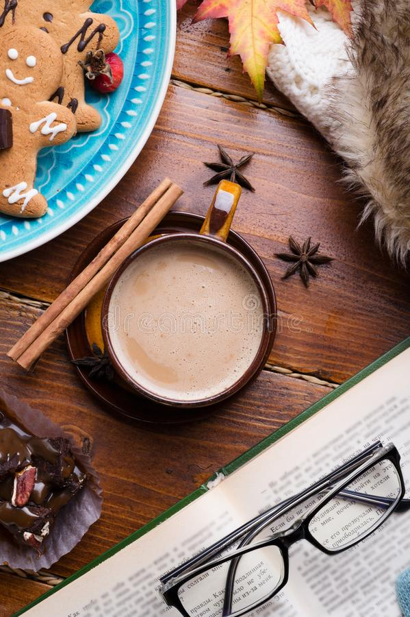 Autumn cozy composition with coffe and book at wooden table. life style concept. flat lay.  stock images