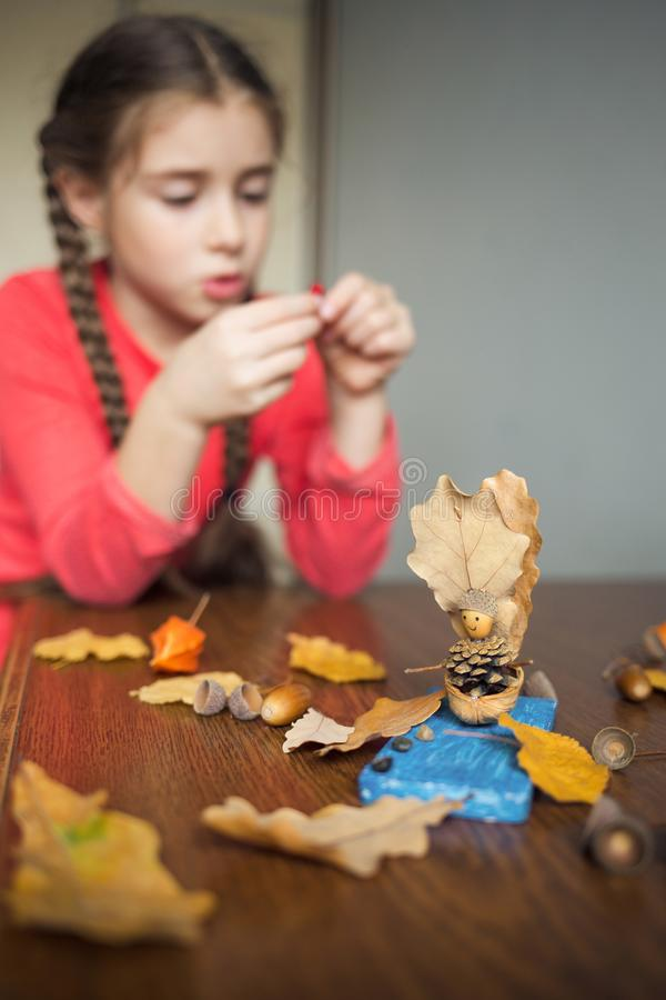 Autumn craft with kids. children`s cute boat with man made of natural materials. process of creating. Autumn craft with kids. children`s cute boat with man made stock image