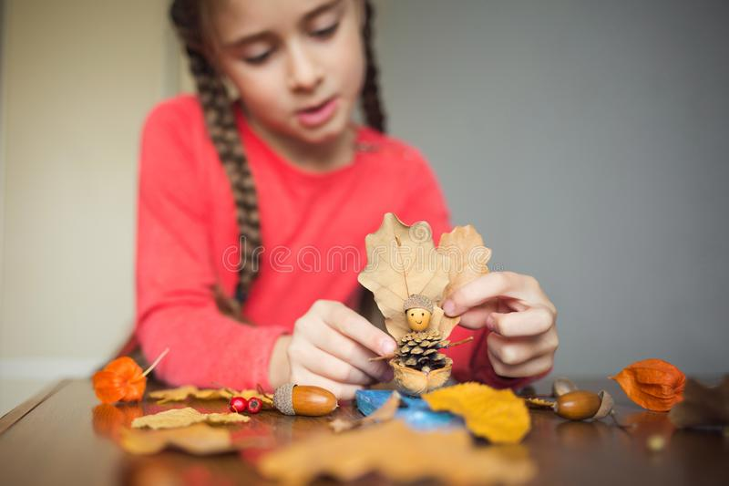 Autumn craft with kids. children`s cute boat with man made of natural materials. process of creating. Autumn craft with kids. children`s cute boat with man made royalty free stock photography