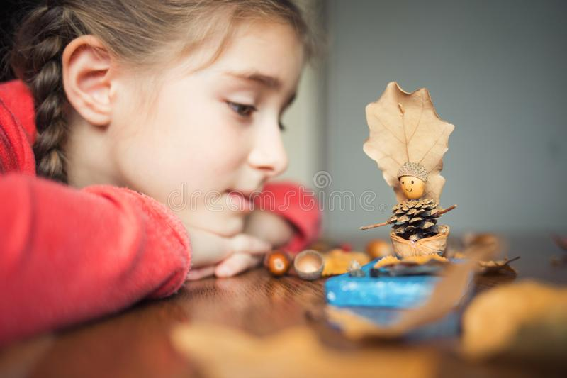 Autumn craft with kids. children`s cute boat with man made of natural materials. process of creating. Autumn craft with kids. children`s cute boat with man made stock photos