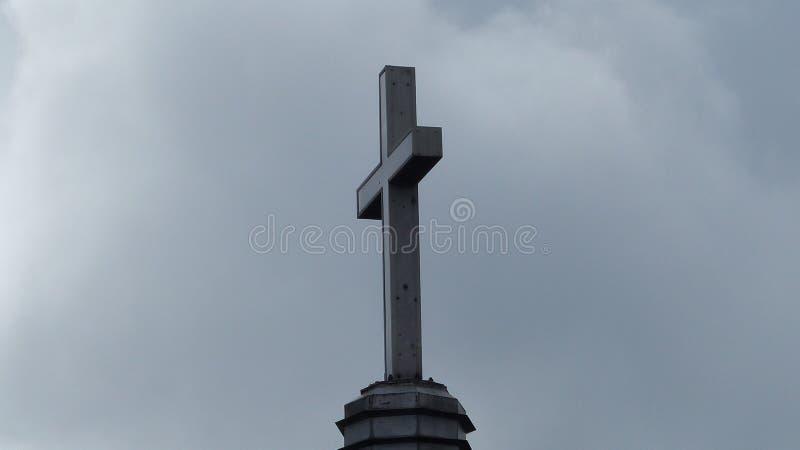 An Autumn Cross. A dark sky looms over a church steeple cross in Autumn royalty free stock photos