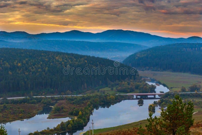 Autumn dawn in the southern Urals. Autumn sunrise in the southern Urals, Bashkortostan. Uzyan River Valley. Bridge stock photography