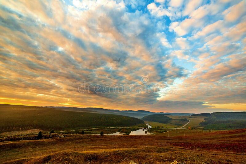 Autumn dawn in the southern Urals. Autumn sunrise in the southern Urals, Bashkortostan. Uzyan River Valley. Bridge royalty free stock images