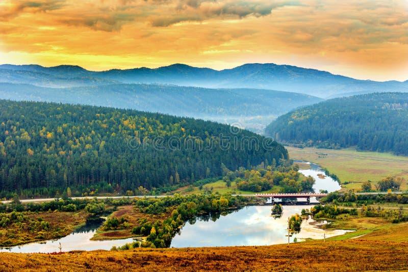 Autumn dawn in the southern Urals. Autumn sunrise in the southern Urals, Bashkortostan. Uzyan River Valley. Bridge stock photos