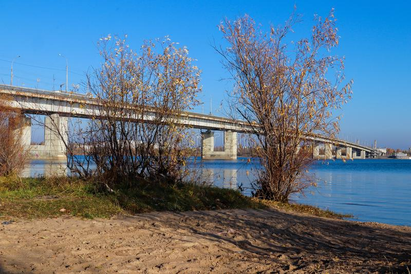 Autumn day in Arkhangelsk. View of the river Northern Dvina and automobile bridge in Arkhangelsk. Island Krasnoflotsky royalty free stock photo