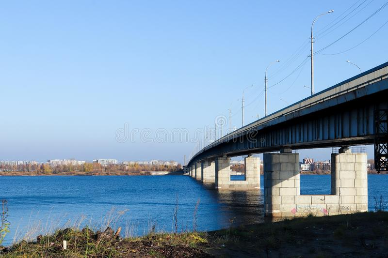 Autumn day in Arkhangelsk. View of the river Northern Dvina and automobile bridge in Arkhangelsk. Island Krasnoflotsky royalty free stock photos