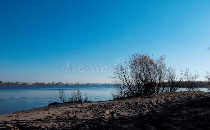Autumn day in Arkhangelsk. View of the river Northern Dvina and river port in Arkhangelsk. Autumn day in Arkhangelsk. View of the river Northern Dvina and royalty free stock photos