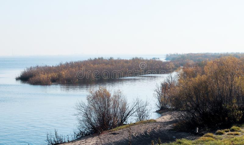 Autumn day in Arkhangelsk. View of the river Northern Dvina and river port in Arkhangelsk. Autumn day in Arkhangelsk. View of the river Northern Dvina and royalty free stock image