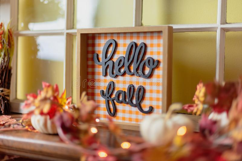 Hello fall sign on the mantel. Autumn decor - Hello Fall sign on the mantel at home royalty free stock images