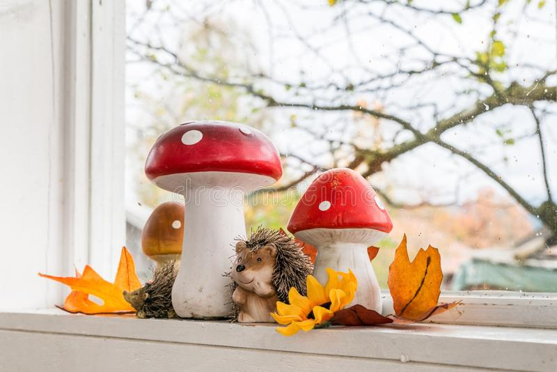 Autumn decoration at home. With view through a window stock photography