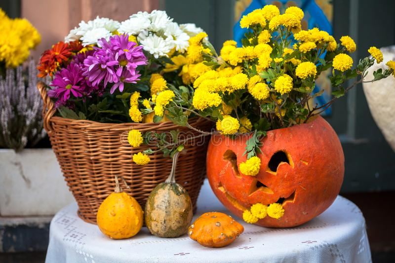 Autumn decoration with pumpkins and flowers on a street in a European city stock photography