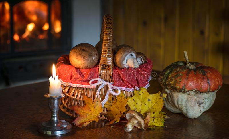Autumn decoration. Autumn table decoration, mushrooms in basket and pumkin royalty free stock photography
