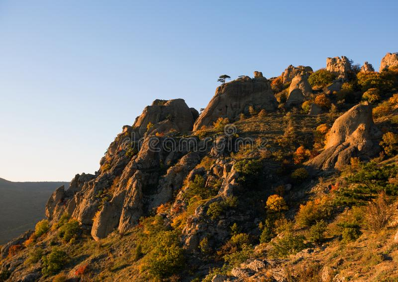 Demerdzhi Rocks in the fall in the evening light. Autumn on Demerdzhi in beautiful evening light royalty free stock photo