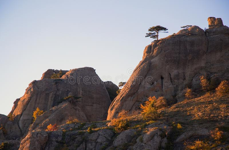 Demerdzhi Rocks in the fall in the evening light. Autumn on Demerdzhi in beautiful evening light royalty free stock image