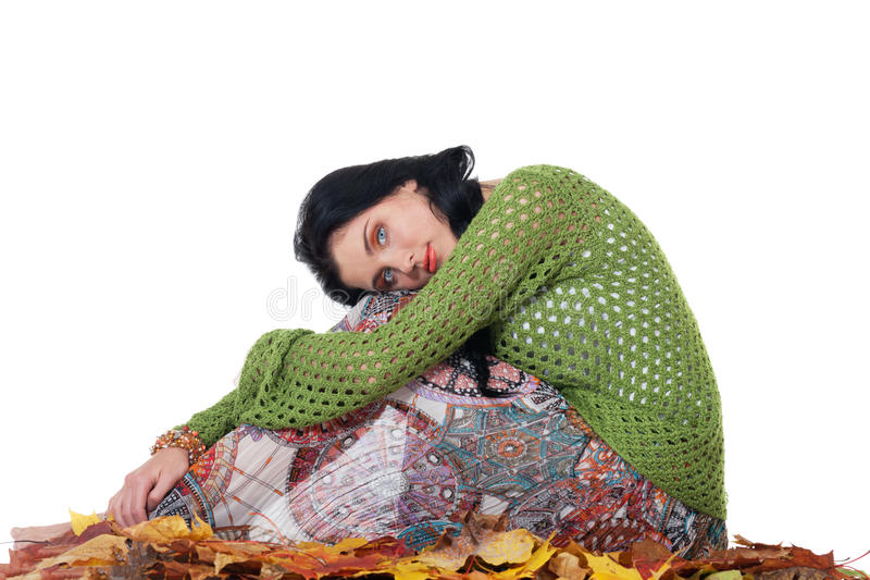Autumn depression. Grief girl sitting on the leaves stock photos
