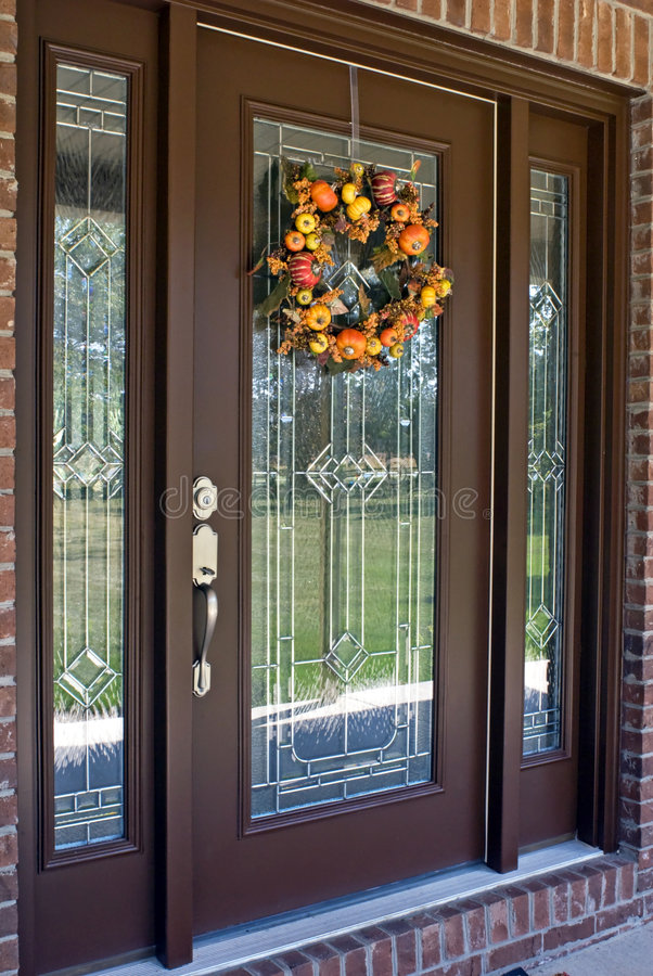 Autumn Door. Modern leaded glass entrance to residential home with fall wreath royalty free stock photos