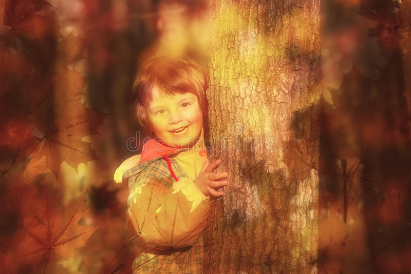 Autumn dream. Happy little girl playing in the autumn forest. Soft-focus, dreamy, abstract image