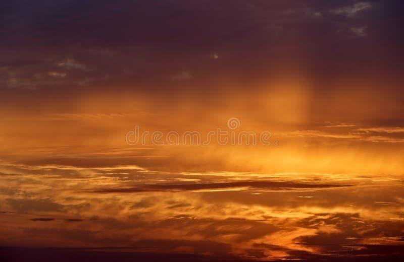Autumn evenings sunset, last rays. Sun sending its last rays to the clouds in autumn evening stock photos