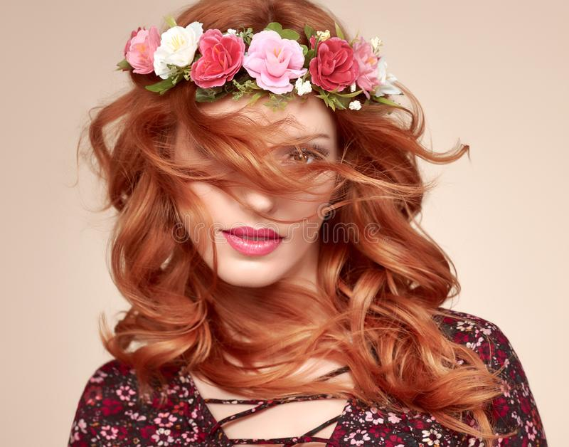 Autumn Fall Fashion. Redhead Woman Portrait.Makeup. Autumn Fall Fashion Portrait. Redhead Model Woman in Stylish Floral Dress, Flower Hairband. Trendy Curly royalty free stock photos