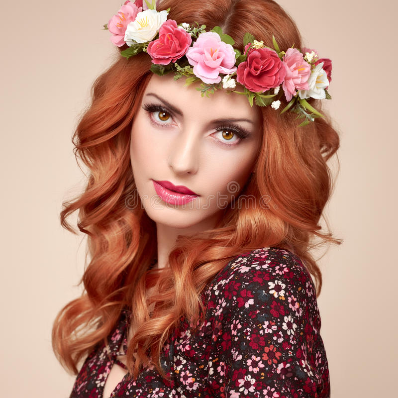 Autumn Fall Fashion. Redhead Woman Portrait.Makeup. Autumn Fall Fashion Portrait. Redhead Model Woman in Stylish Floral Dress, Flower Hairband. Trendy Curly stock photography