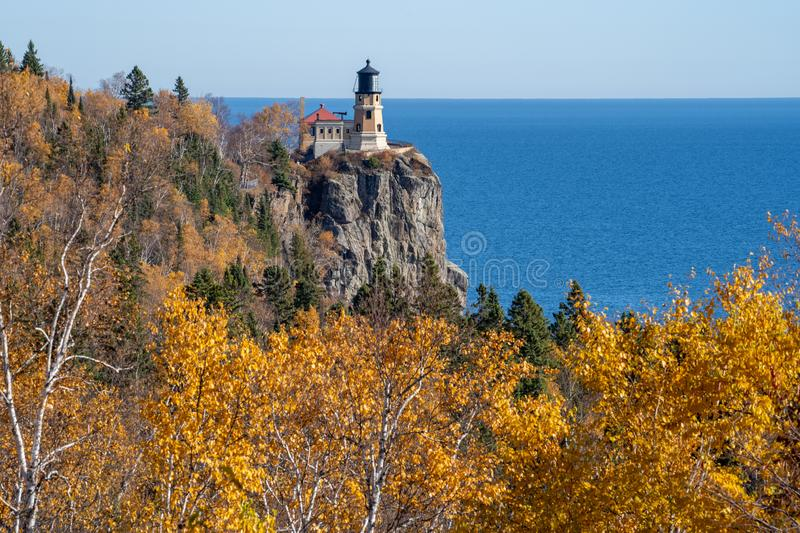 Autumn fall leaves with Split Rock Lighthouse in the distance on Lake Superior Minnesota.  stock image