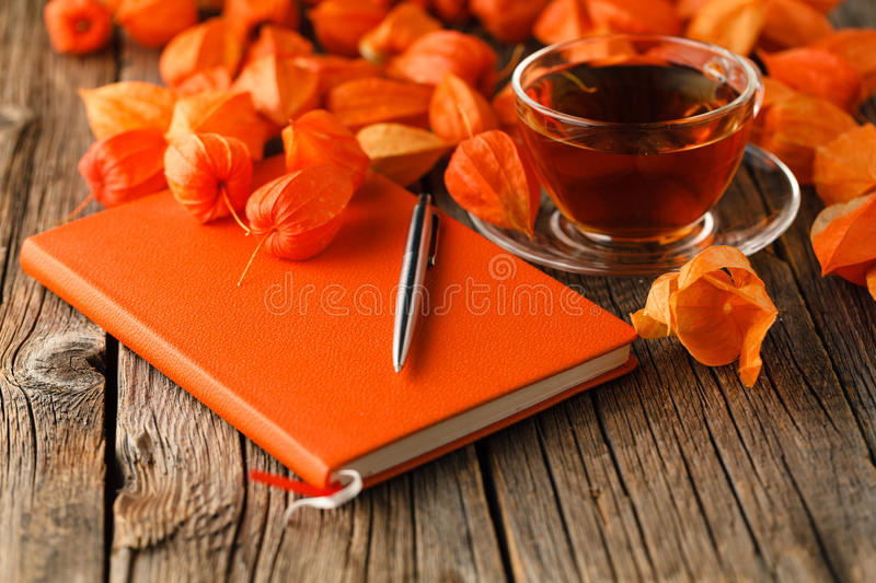 Autumn fall still life with cup of tea, colorful leaves over stock images