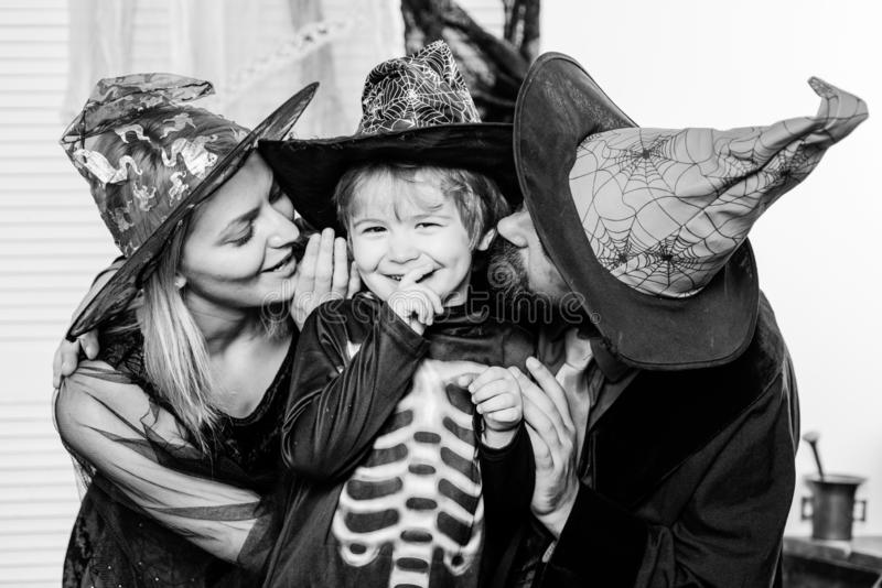 Autumn family love. Traditions for October 31. Mother, son and father celebrate Halloween. Holiday for Toddler. Happy royalty free stock photo