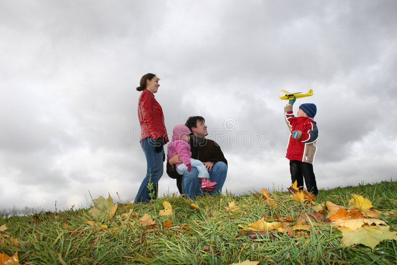 Autumn family with plane stock photography
