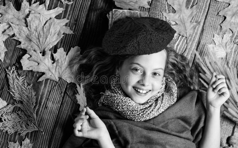 Autumn fashion accessory concept. Fashion trend fall season. Girl lay wooden background fallen leaves top view. Knitted. Accessory fashion detail. Fashion royalty free stock photos