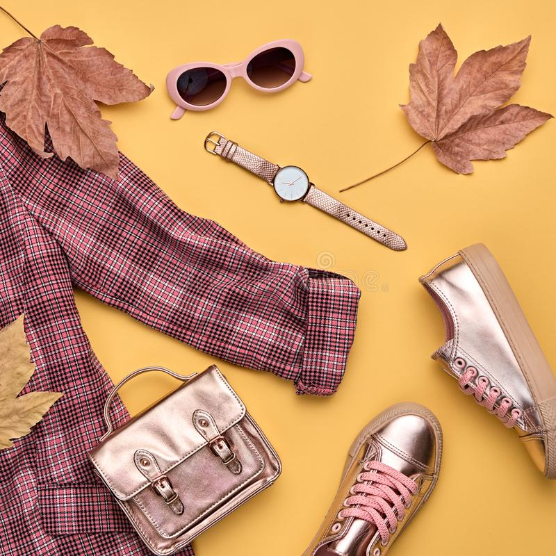 Autumn Fashion Clothes Flat lay, Leaf. Fall Outfit. Fall fashion Clothes Accessories Outfit, Maple Leaf. Autumn creative minimal Flat lay. Trendy coral jacket stock image